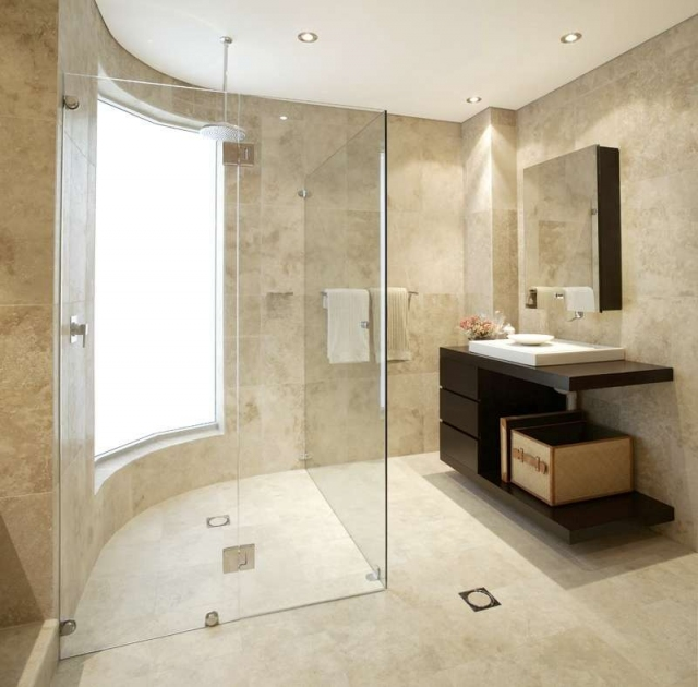 Clear glass around shower makes bathroom appear larger